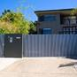 Custom designed automatic sliding gate with matching pedestrian access gate and intercom system