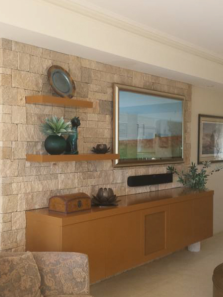 Beautiful stone wall adds warm whilst hiding all those ugly wires. The Mirror TV is a stunning addition.